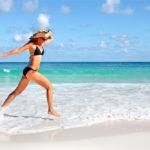 Woman-summer-body-running-on-beach