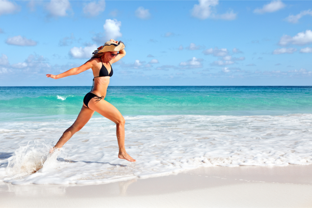 woman-summer-body-running-on-beach