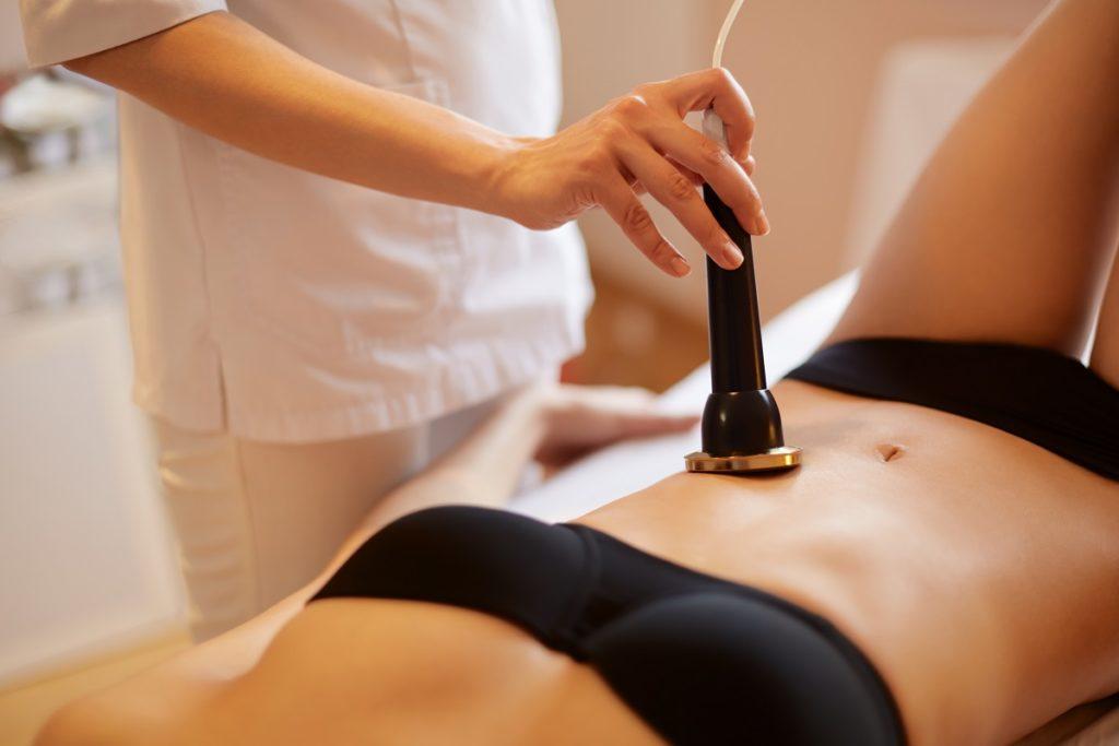 Woman undergoing lipo cavitation
