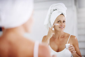 face-cream-application-older-woman