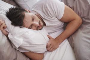 man-sleeping-on-pillow