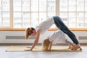 woman-doing-yoga-with-daughter