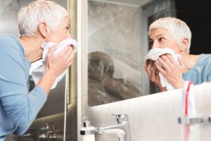 older-woman-washing-face
