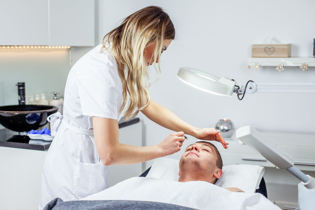 man undergoing facial treatment