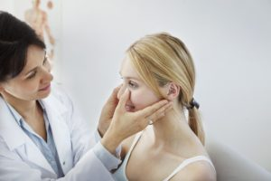 Doctor holding a patient's face