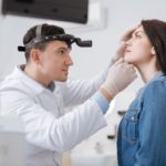 Doctor Looking At The Patient's Nose
